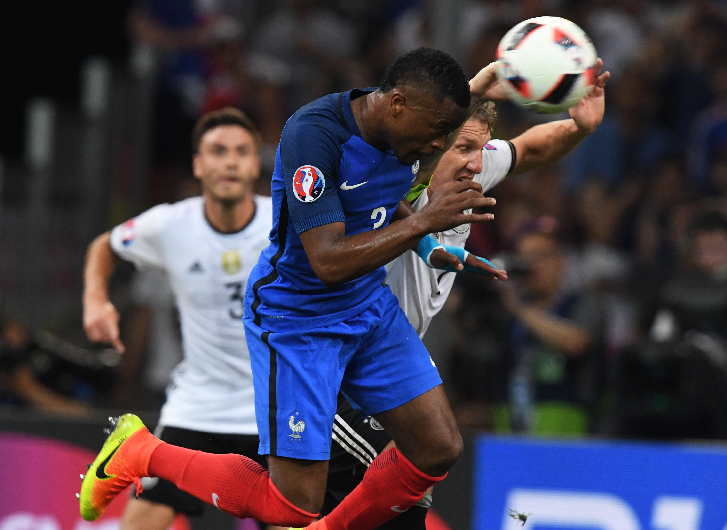 Germany's Bastian Schweinsteiger (R) and Patrice Evra of France vie for the ball during the UEFA EURO 2016 semi final soccer match between Germany and France at the Stade Velodrome in Marseille, France, 07 July 2016. Photo: Peter Kneffel/dpa (RESTRICTIONS APPLY: For editorial news reporting purposes only. Not used for commercial or marketing purposes without prior written approval of UEFA. Images must appear as still images and must not emulate match action video footage. Photographs published in online publications (whether via the Internet or otherwise) shall have an interval of at least 20 seconds between the posting.) +++(c) dpa - Bildfunk+++